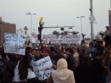 Demonstrators holding banners and Egyptian flags